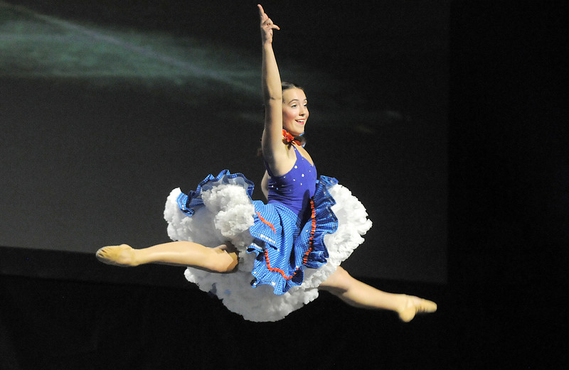 Sophie Payannet (Danse Etoile Ballet) goes to the air while dancing with Randy Ahrens at Dancing With The Broomfield Stars at the 1stBank Center.<br /> September 22, 2011<br /> staff photo/ David R. Jennings