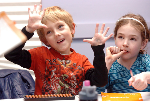 Tanner Simpson, 6, left, and Kathryn Proctor, 7, work on problems during abacus math class at the Davinci Center for Creative Arts on Wednesday.<br /> <br /> January 5, 2011<br /> staff photo/David R. Jennings