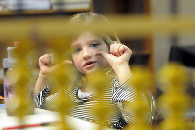 Riley MacQueen, 6 1/2, uses her hands in the air to understand the abacus during abacus math class at the Davinci Center for Creative Arts on Wednesday. January 5, 2011 staff photo/David R. Jennings