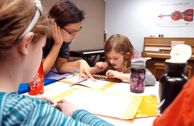 Anita Khedkar, center, helps Riley MacQueen, 6 1/2, right, with Kathryn Proctor, 7, during abacus math class at the Davinci Center for Creative Arts on Wednesday. January 5, 2011 staff photo/David R. Jennings