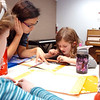 Anita Khedkar, center, helps Riley MacQueen, 6 1/2, right, with Kathryn Proctor, 7, during abacus math class at the Davinci Center for Creative Arts on Wednesday.<br /> January 5, 2011<br /> staff photo/David R. Jennings