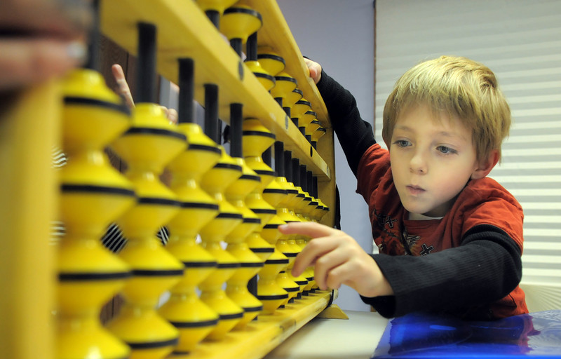 Tanner Simpson, 6 1/2, uses a large abacus during abacus math class at the Davinci Center for Creative Arts on Wednesday.<br /> January 5, 2011<br /> staff photo/David R. Jennings