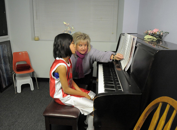 Ashley Panem, 10, left, listens to piano teacher Jyllian James during class at the Davinci Center for Creative Arts on Wednesday.<br /> January 5, 2011<br /> staff photo/David R. Jennings