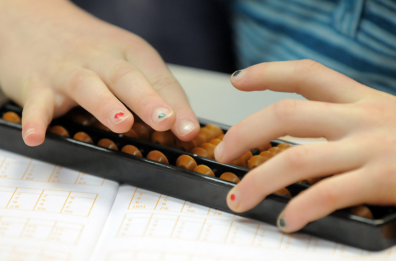 Kathryn Proctor, 7, uses an abacus during abacus math class at the Davinci Center for Creative Arts on Wednesday.<br /> January 5, 2011<br /> staff photo/David R. Jennings
