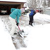 Shane Kaiser, 12, right, with the help of his sister Chelsea, 17, left,  shovel snow from the driveway of Shane's customer during the late December snowstorm on Thursday. <br /> <br /> December 22, 2011<br /> staff photo/ David R. Jennings