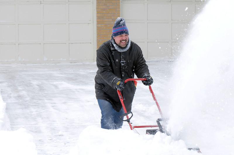 Kelly Rasmussen works his snowblower to clear snow from his driveway on Flint Way during the late  December snowstorm on Thursday. <br /> <br /> December 22, 2011<br /> staff photo/ David R. Jennings