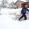 Shane Kaiser, 12, right, with the help of his sister Chelsea, 17,  shovel snow from the driveway of Shane's customer during the late December snowstorm on Thursday. <br /> <br /> December 22, 2011<br /> staff photo/ David R. Jennings