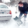 Tyler Scholes, 18, right, helps shovels out a neighbor's car that was stuck on East Holly Dr. during the December snow storm on Thursday.<br /> <br /> December 22, 2011<br /> staff photo/ David R. Jennings