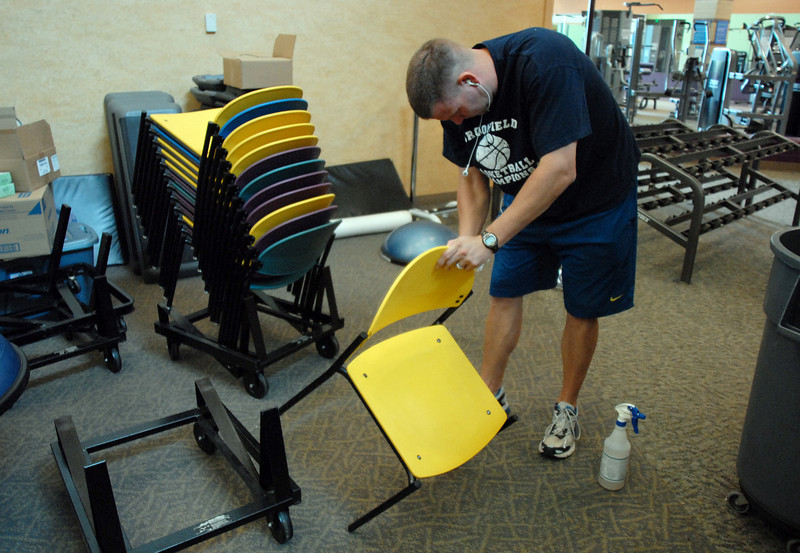 Aaron Stewart cleans chairs in the weight area during cleaning week at the Derda Recreation Center on Tuesday. <br /> August 24, 2010<br /> staff photo/David R. Jennings