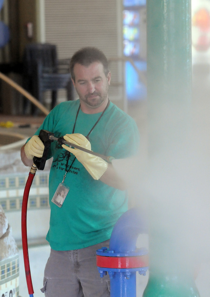Andy Larington power washes part of the pool during cleaning week at the Derda Recreation Center on Tuesday. <br /> August 24, 2010<br /> staff photo/David R. Jennings