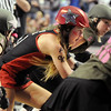 Jammer Fonda Payne, Bad Apples, skates through the pack during a jam against the Green Barrettes in Saturday's first Denver Roller Dolls bout at the 1stBank Center. <br /> <br /> March 20, 2010<br /> Staff photo/David R. Jennings