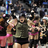 Kish of Death celebrates the Green Barrettes win over  Shotgun Betties during Saturday's first Denver Roller Dolls bout at the 1stBank Center. <br /> <br /> March 20, 2010<br /> Staff photo/David R. Jennings
