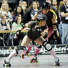 "Tracy ""Disco"" Akers, Green Barrettes, keeps Alex Termination, Shotgun Betties, from advancing during Saturday's first Denver Roller Dolls bout at the 1stBank Center. <br /> <br /> March 20, 2010<br /> Staff photo/David R. Jennings"