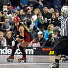 Jammer Fonda Payne, Bad Apples, skates ahead of the pack as a referee signals during the jam against the Green Barrettes in Saturday's first Denver Roller Dolls bout at the 1stBank Center. <br /> <br /> March 20, 2010<br /> Staff photo/David R. Jennings