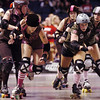 "Danica ""Berlin Brawl"" Dolezal, left, Shotgun Betties, and  Vicky ""Slick Vick"" Cruz, Green Barrettes work their way trough the pack during Saturday's first Denver Roller Dolls bout at the 1stBank Center.<br /> March 20, 2010<br /> Staff photo/David R. Jennings"