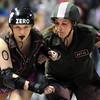Moira Lee DeVoid, Shotgun Betties is blocked by Metal-Lixx, Green Barrettes during Saturday's first Denver Roller Dolls bout at the 1stBank Center. <br /> <br /> March 20, 2010<br /> Staff photo/David R. Jennings