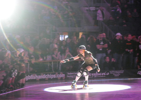 Elle Yeah with the Green Barrettes is introduced to the record breaking crowd for Saturday's first Denver Roller Dolls bout at the 1stBank Center. <br /> <br /> March 20, 2010<br /> Staff photo/David R. Jennings