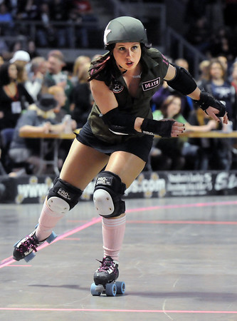 "Jammer Julie ""Angela Death"" Adams, Green Barrettes, skates on the flat course during Saturday's first Denver Roller Dolls bout at the 1stBank Center. <br /> <br /> March 20, 2010<br /> Staff photo/David R. Jennings"