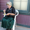 Peggy Atkinson, curator of the Depot Hill Museum, eats some birthday cake during the Broomfield Depot Museum 100th anniversary party on Saturday<br /> October 17, 2009<br /> Staff photo/David R. Jennings