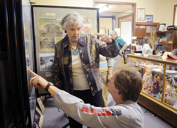 Helen Kozisek, left, talks to Dennis Schwartz about Broomfield history during the Broomfield Depot Museum 100th anniversary party on Saturday.<br /> October 17, 2009<br /> Staff photo/David R. Jennings