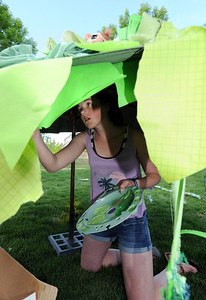 Sophie Kelly paints the underside of an umbrella while working on the set for the Destination Imagination 7th grade team the Creativity Club presentation for the Global Finals in Tennessee.  May 10, 2012  staff photo/ David R. Jennings