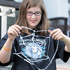 Grace Rome looks at the duct tape spider web prop while working on the set for the Destination Imagination 7th grade team the Creativity Club presentation for the Global Finals in Tennessee.<br /> <br /> May 10, 2012 <br /> staff photo/ David R. Jennings