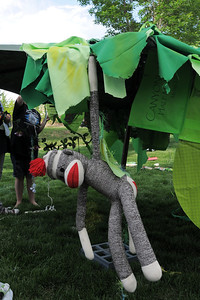 A toy monkey is sewn to an umbrella representing a tree for the set for the Destination Imagination 7th grade team the Creativity Club presentation for the Global Finals in Tennessee.  May 10, 2012  staff photo/ David R. Jennings