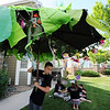 Nick Solusod carries an umbrella, repesenting a tree, for furhter decoration for the set of the Destination Imagination 7th grade team the Creativity Club presentation for the Global Finals in Tennessee.<br /> <br /> May 10, 2012 <br /> staff photo/ David R. Jennings