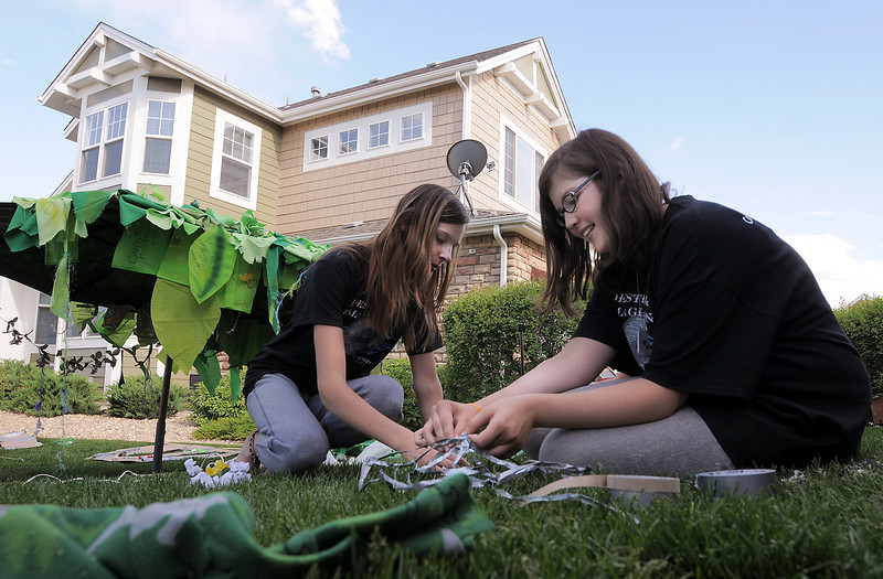Hannah Freeman, left, and Grace Rome build a spider's web from duct tape while working on the set for the Destination Imagination 7th grade team the Creativity Club presentation for the Global Finals in Tennessee.<br /> May 10, 2012 <br /> staff photo/ David R. Jennings