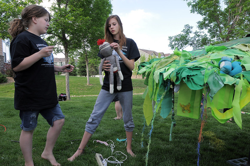 Claire Hamilton, left, and Hannah Freeman dicuss how to attach a toy monkey to the umbrella while working on the set for the Destination Imagination 7th grade team the Creativity Club presentation for the Global Finals in Tennessee.<br /> <br /> <br /> May 10, 2012 <br /> staff photo/ David R. Jennings