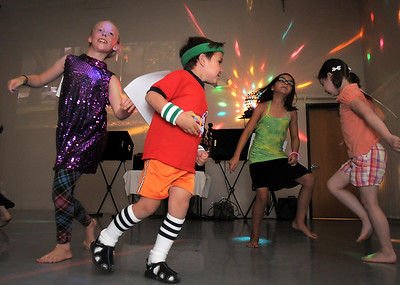 Guillano Busnardo, 6, center, dances during the disco dance off for the School of Ballet Nouveau Colorado at the BNC studio on Saturday. July 9, 2011 staff photo/ David R. Jennings