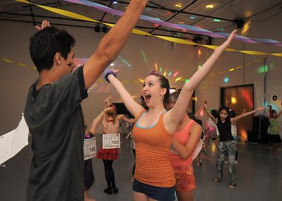 """Antonio Louck, 14, left, dances with Melissa Learish, 14, to """"YMCA"""" during the disco dance off for the School of Ballet Nouveau Colorado at the BNC studio on Saturday. July 9, 2011 staff photo/ David R. Jennings"""