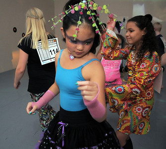 Hannah Herrick, 10, center, dances while dressed in a 1970's period costume, for  the disco dance off for the School of Ballet Nouveau Colorado at the BNC studio on Saturday. July 9, 2011 staff photo/ David R. Jennings