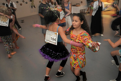 Greer Harper, 9, right, dances with Hannah Herrick, 10, during the disco dance off for the School of Ballet Nouveau Colorado at the BNC studio on Saturday. July 9, 2011 staff photo/ David R. Jennings