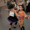 Greer Harper, 9, right, dances with Hannah Herrick, 10, during the disco dance off for the School of Ballet Nouveau Colorado at the BNC studio on Saturday.<br /> July 9, 2011<br /> staff photo/ David R. Jennings