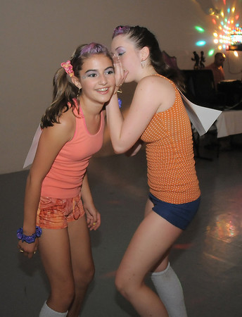 Megan Moore, 14, left, listens to a whisper by Melissa Learish, 14,  during the disco dance off for the School of Ballet Nouveau Colorado at the BNC studio on Saturday.<br /> July 9, 2011<br /> staff photo/ David R. Jennings