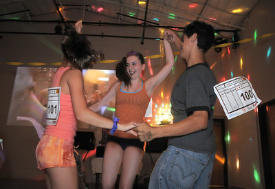 Megan Moore, 14, left, Melissa Learish, 14, and Antonio Houck, 14, dance together during the disco dance off for the School of Ballet Nouveau Colorado at the BNC studio on Saturday. July 9, 2011 staff photo/ David R. Jennings