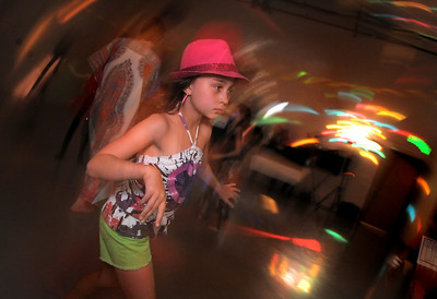 Stella Schitter, 9, stays in character while dancing during the disco dance off for the School of Ballet Nouveau Colorado at the BNC studio on Saturday. July 9, 2011 staff photo/ David R. Jennings
