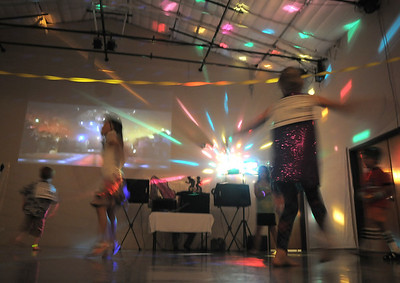 Students dance in the disco light during the disco dance off for the School of Ballet Nouveau Colorado at the BNC studio on Saturday. July 9, 2011 staff photo/ David R. Jennings