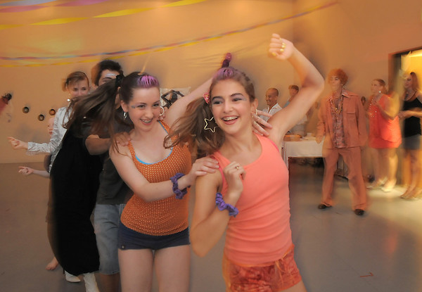 Megan Moore, 14, right, and Melissa Learish, 14, lead the conga line during the disco dance off for the School of Ballet Nouveau Colorado at the BNC studio on Saturday.<br /> July 9, 2011<br /> staff photo/ David R. Jennings