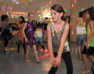 Paloma Acquafresca, 9, dances with fellow students during the disco dance off for the School of Ballet Nouveau Colorado at the BNC studio on Saturday. July 9, 2011 staff photo/ David R. Jennings