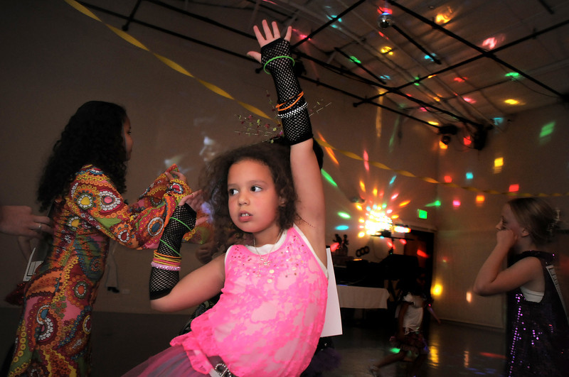 Delany Harper, 6, dances to 70's music during the disco dance off for the School of Ballet Nouveau Colorado at the BNC studio on Saturday.<br /> July 9, 2011<br /> staff photo/ David R. Jennings