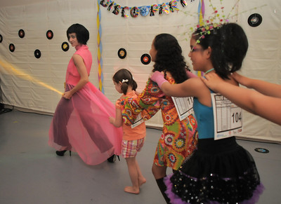 BNC associate artistic director Dawn Fay, left, leads a conga line during the disco dance off for the School of Ballet Nouveau Colorado at the BNC studio on Saturday. July 9, 2011 staff photo/ David R. Jennings