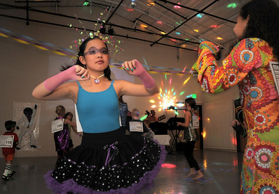 Hannah Herrick, 10, left, dances with Greer Harper, 9, during the disco dance off for the School of Ballet Nouveau Colorado at the BNC studio on Saturday. July 9, 2011 staff photo/ David R. Jennings