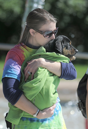 Lindsey Terranova wrapped her dog Belford in her jacket to keep him warm during Dog Daze at the Bay on Saturday.<br /> September 10, 2011<br /> staff photo/ David R. Jennings