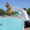 Bryan McCready tosses his boxer mix Cooper into the water during Dog Daze at the Bay on Saturday.<br /> September 10, 2011<br /> staff photo/ David R. Jennings