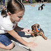Ashley Goldston, 7, pulls her dog Lola out of the water of the kiddy pool  during Dog Daze at the Bay on Saturday.<br /> September 10, 2011<br /> staff photo/ David R. Jennings