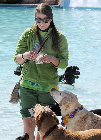 Lindsey Terranova hands out treats to her and other dogs during Dog Daze at the Bay on Saturday.<br /> September 10, 2011<br /> staff photo/ David R. Jennings