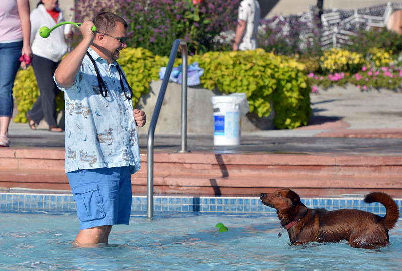 Chris Volek gets ready to toss a ball for his dog Vinny to retrieve during the first session of Dog Daze at the Bay on Saturday at The Bay Aquatic Park.<br /> September 8, 2012<br /> staff photo/ David R. Jennings