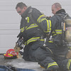 North Metro Fire Rescue District firefighters prepare the fire at  308 Mulberry Circle on Saturday. No reports of injuries and the cause of the fire is under investigation.<br /> <br /> March 6, 2010<br /> Staff photo/David R. Jennings
